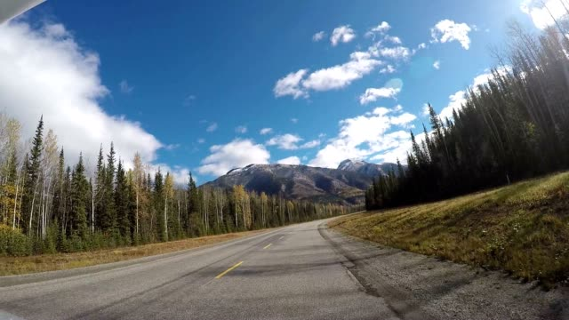 Car driving POV on scenic Canadian roads