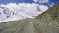 POV Car driving on snowy and winding mountain road/Qinghai,China.