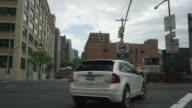 Car POV driving onto Brooklyn Bridge heading towards Manhattan