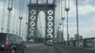 Car POV driving over Manhattan Bridge toward Brooklyn