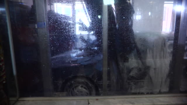 MS Car driving through carwash / Brooklyn, New York, USA