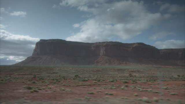 SIDE POV car driving through desert