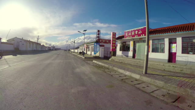 POV Car driving through small town in pastoral areas/Qinghai,China.