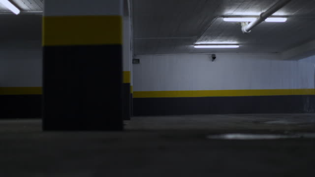 Car entering parking garage, four shots