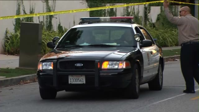 Car Leaving Crime Scene on December 30 2013 in Los Angeles California