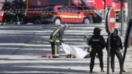 A car loaded with gas canisters has rammed into a police van on the Champs Elysees avenue in Paris leaving the driver dead in what the interior...