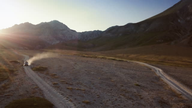 Car offroad adventures on the mountain: drone aerial view