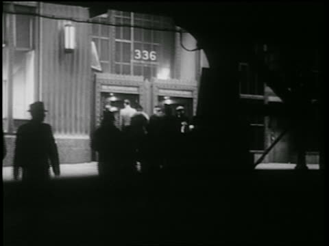B/W 1939 car point of view from shadows of people entering office building / NYC / documentary