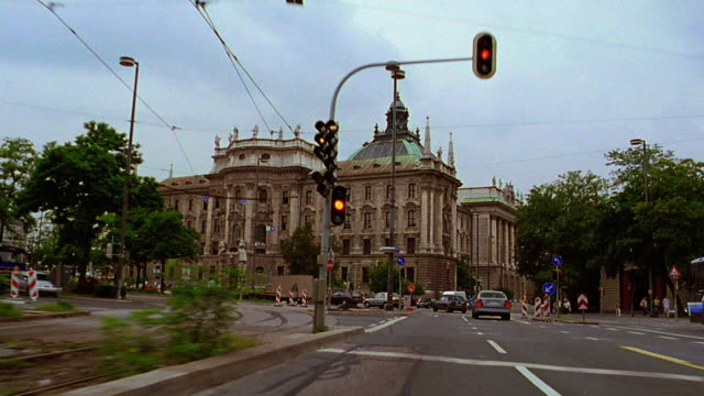 Car point of view in traffic on street toward Palace of Justice / Munich, Germany