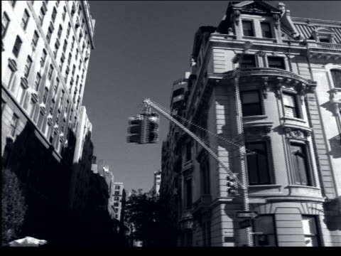 B/W car point of view of ornate buildings on Fifth Avenue / NYC