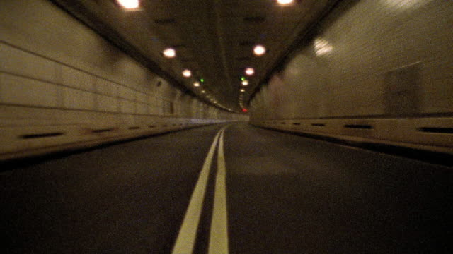 Car point of view through tunnel / NYC