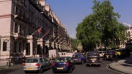 Car point of view PAN traffic on London street / England
