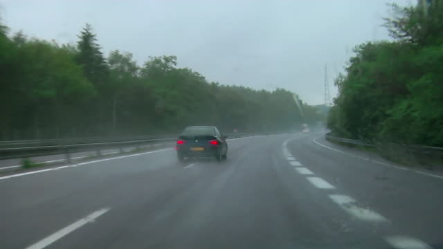 Car point of view traveling on A4 autoroute between Strasbourg and Metz on rainy day / France