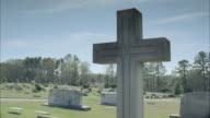 MS Car pulls into cemetery dotted with tombstones / Newnan, Georgia, United States