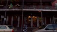 SIDE POV car riding on Bourbon Street, New Orleans, Louisiana, USA
