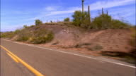 3/4 REAR POV, Car riding on desert highway, Arizona, USA