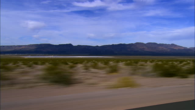 SIDE POV, Car riding on highway, Boulder City, Nevada, USA
