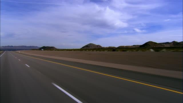 3/4 REAR POV, Car riding on highway, Boulder City, Nevada, USA