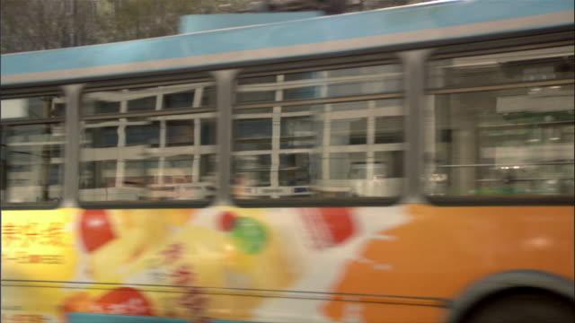 SIDE POV, SLO MO, Car riding through city, Beijing, China
