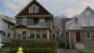 SIDE POV car riding through residential district, Rochester, New York, USA