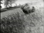 PAN, SHAKY, B/W, Car rolling down hill, USA