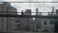 Car side POV driving over Manhattan Bridge toward Brooklyn with NYC skyline in distance