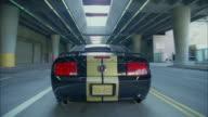 POV, car speeding away in tunnel, Los Angeles, California, USA