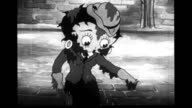 Car sprays Betty Boop with muddy water