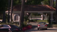 A car stops at the entrance to a country club in Los Angeles.