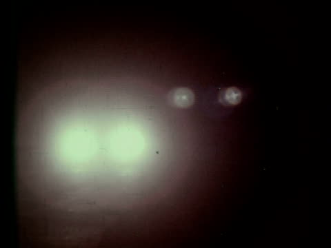 Car swerving on darkened road at night headlights weaving / cars passes by Car weaving on road at night on January 01 1969
