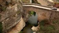 Car through stony bridge
