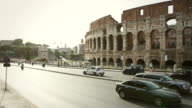 Car traffic by the Coliseum of Rome
