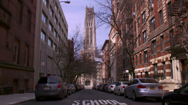 A car travels down 121st street by Union Theological Seminary in Harlem