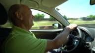 Car Trip, happy senior man driving with his new car