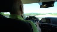 Car Trip, senior man driving his car on motorway