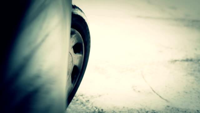 HD: Car Wheel Sliding on Snowy Road