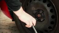 HD - Car Wheel Unscrewing Close-up
