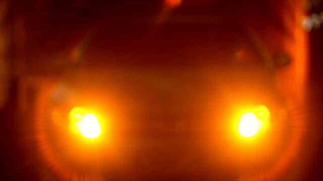 Car with flashing hazard lights at night