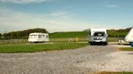Caravan trailer towed on a campsite