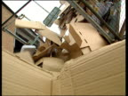 Cardboard tipped out of lorry for recycling