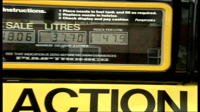 Cardiff 0240 EXT Action petrol station owner Donald Humphries at unleaded pump on forecourt looks at prices BV Humphries as looks at price for...
