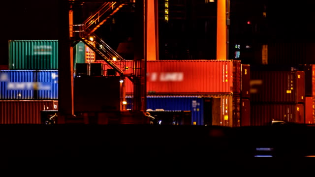 Container Warehouse Arbeiten bei Nacht, TIMELAPSE