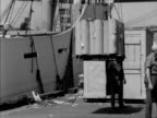 Cargo is loaded onto a ship at the docks in New York City