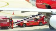 Cargo loading to Airplane,Panning Shot