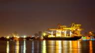 Cargo Schiff in Shipyard Terminal dusk to Night Time lapse