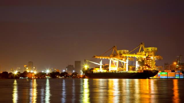 Cargo Ship at Shipyard Terminal dusk to Night Time lapse
