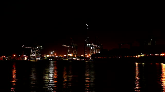 Cargo ship in the harbor at night.