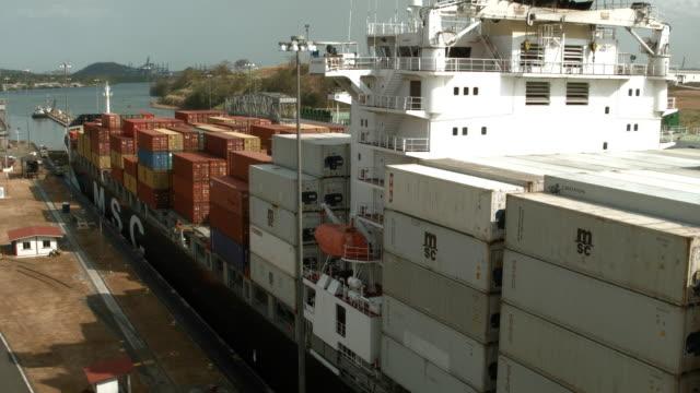 A cargo ship makes its way through the Miraflores locks as it crosses the Panama Canal on April 7 2016 in Panama City Panama A $53 billion Panama...