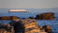 Cargo Ship sailing at sunset