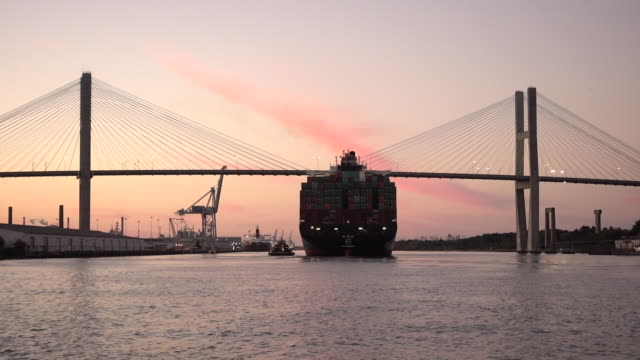 Cargo ship traveling up river